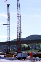 Construction cranes stand watch over SR-52 construction.