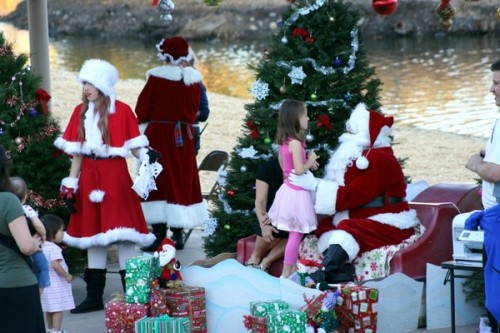 Santa Claus greets a young Santee resident during a previous Santa at the Lakes celebration